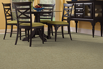 Dining room scene with green Softique carpet
